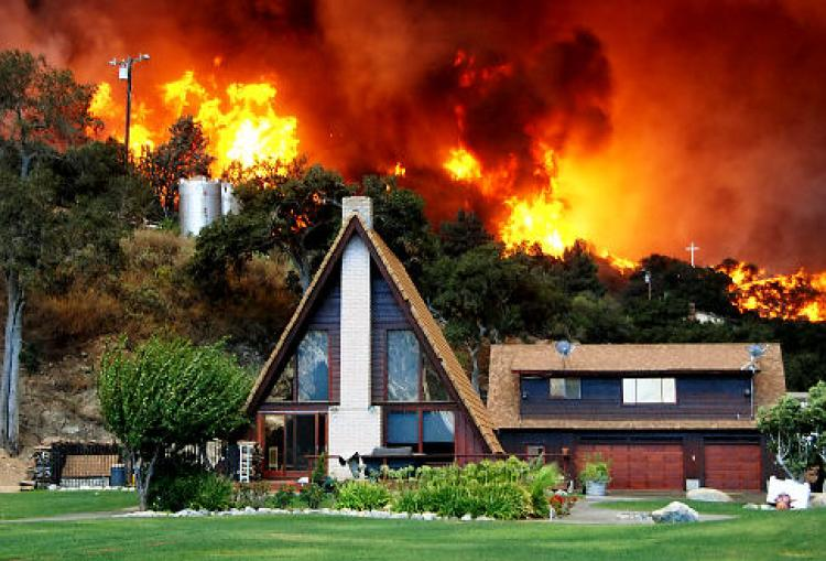 NY daily news took a great photo of this modern house, about to become fiery ashes on the ground in LA canada flintridge California Wildfire, where two firefighters died in the fire and one body found dead.