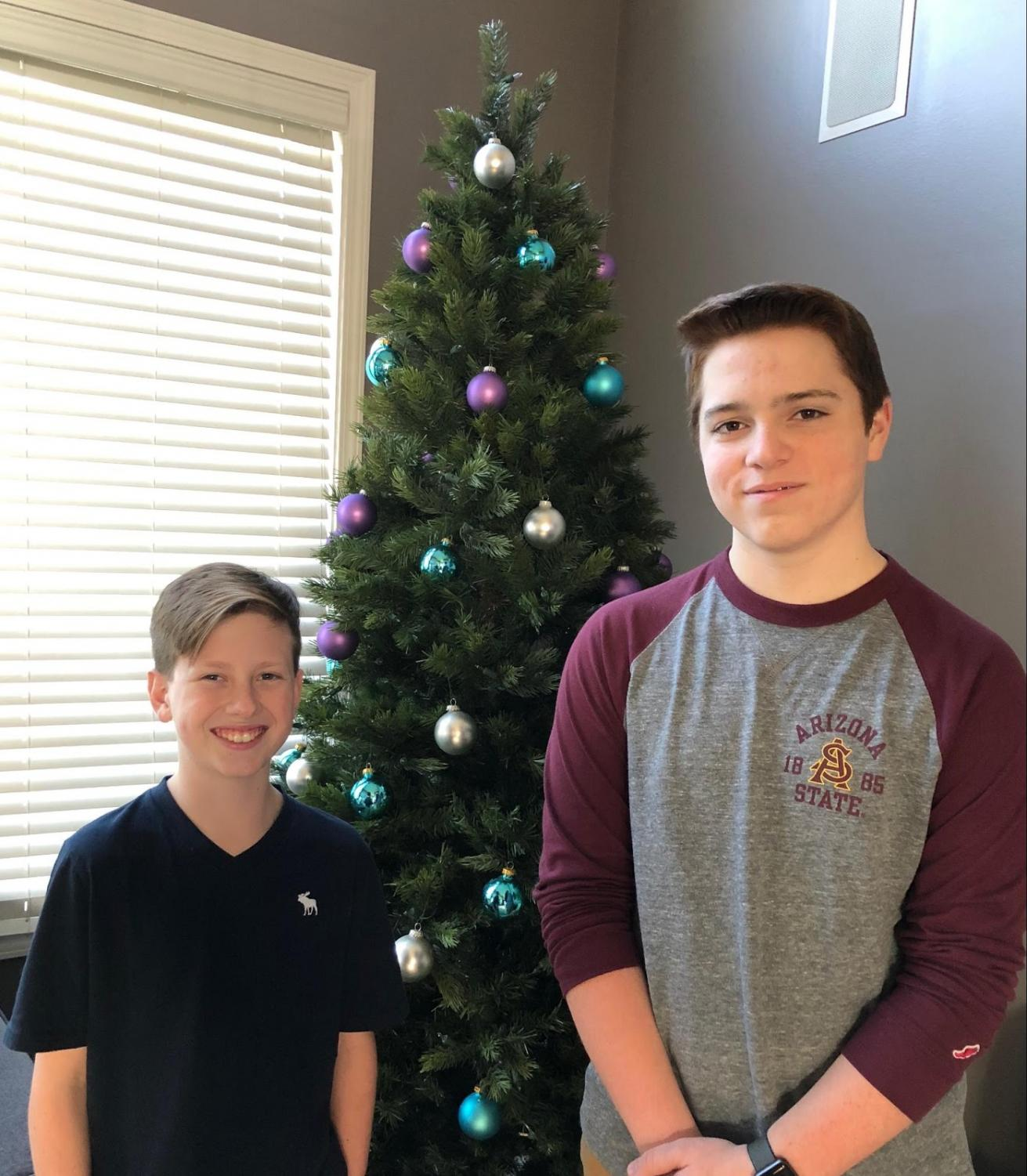 Two of The Bite reporters (7th grade), Josh Arsaro and Nate Sulak pose in front of a Christmas Tree at Nate's home.