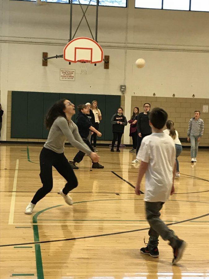 Seventh+grader%2C+Mira+Vulaj+hits+the+volleyball+in+a+game+during+indoor+recess.%0A