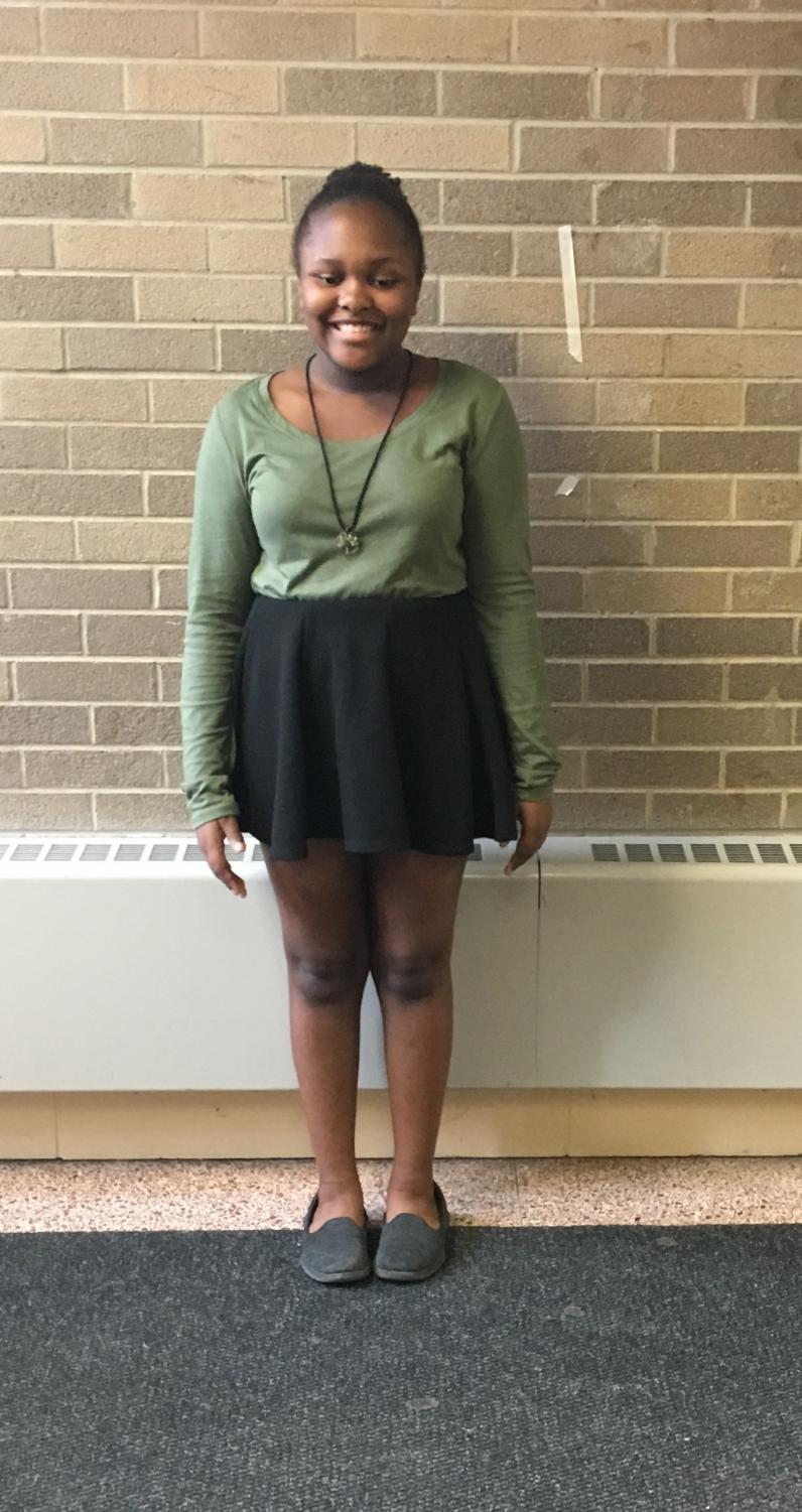Nailah Spencer, seventh grade journalist, is wearing a skirt that does not follow our school's dress code.