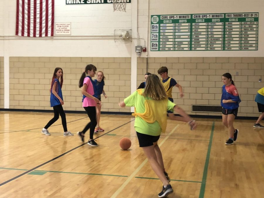 West students played soccer in the gym.