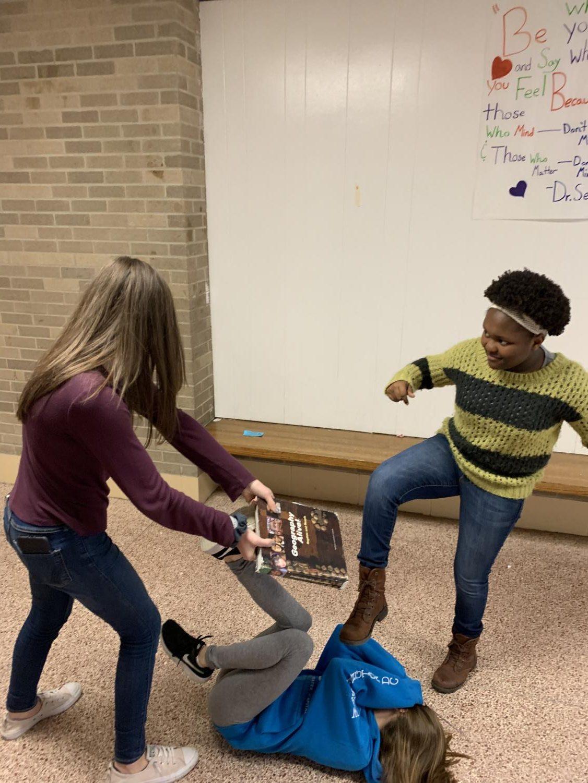Nailah Spencer (7th grade), Maya Mitts (7th grade), and Viviana Buzzelli (7th grade) act out a bullying scenario.