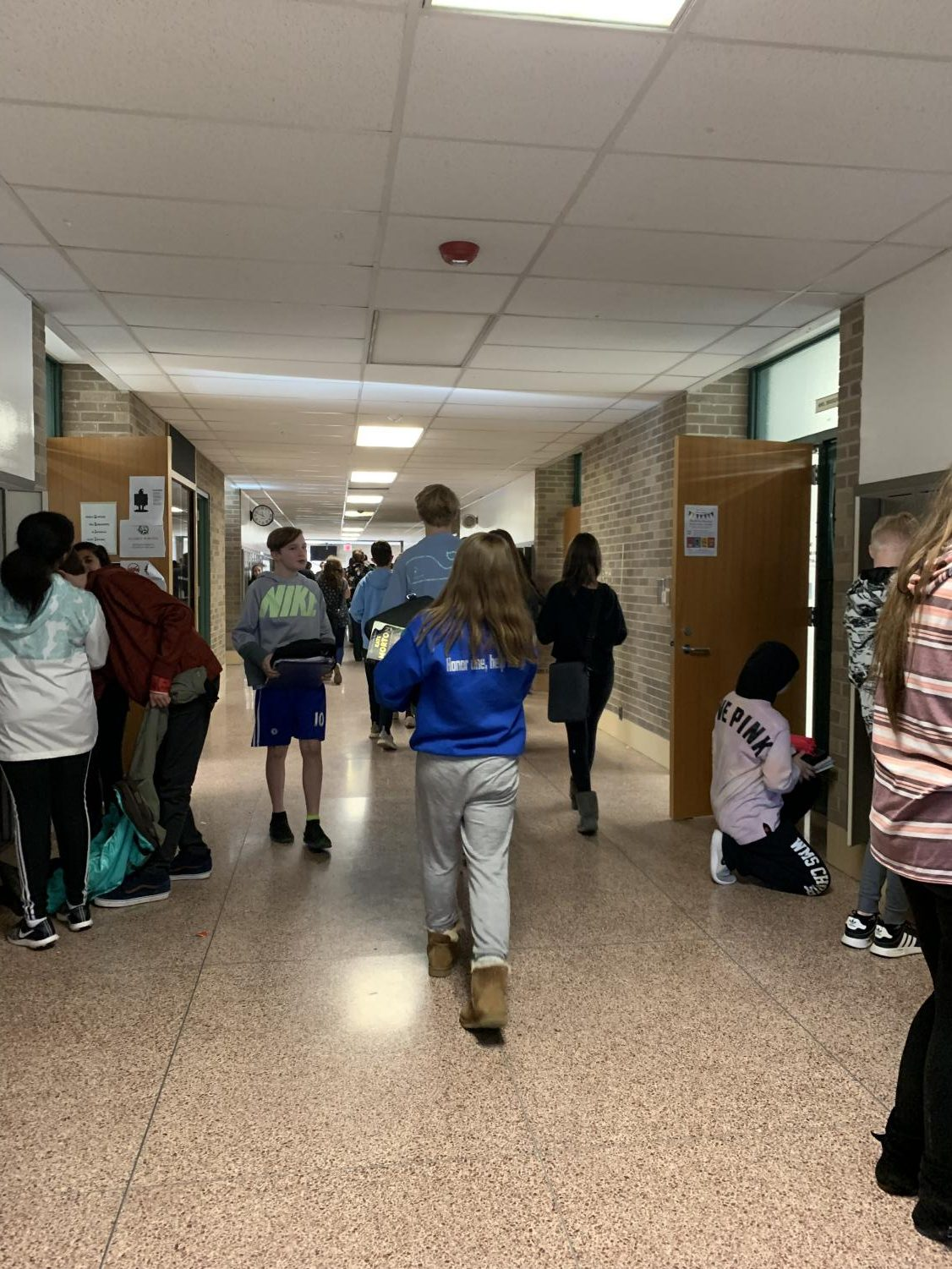 Students during passing time in C-Wing hallway.