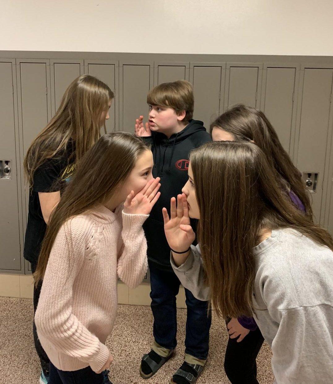 Journalism student acting common hallway behavior.