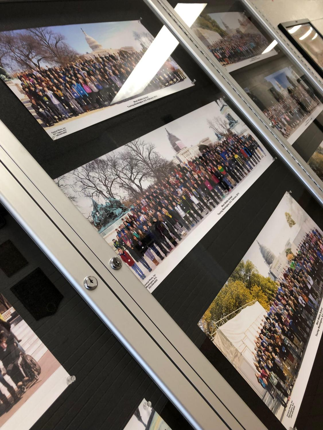Photographs from previous Washington D.C. trips hanging in the counselor hallway.