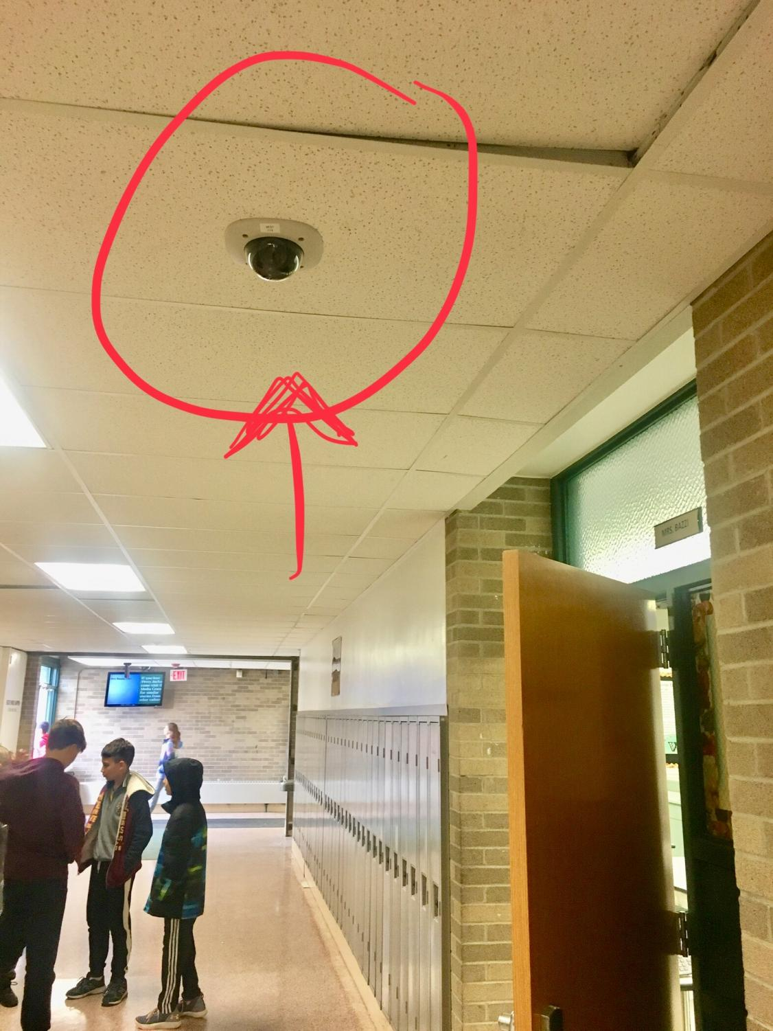 Security camera in C Wing outside of Mrs. Bazzi's classroom door.