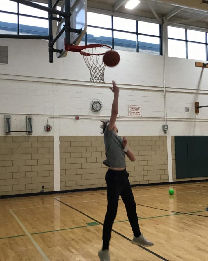 Leo+Jividen+shoots+a+layup+while+thinking+about+Kobe+in+the+West+gym.+