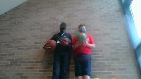 West students holding sports equipment for recess.