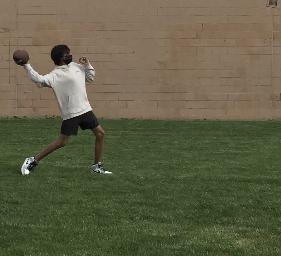 Veeran Dhaliwal throws football outside of West.