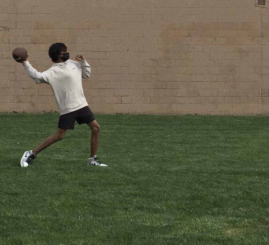 Veeran+Dhaliwal+throws+football+outside+of+West.+