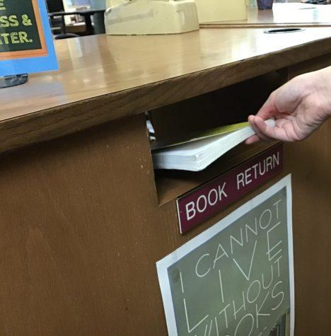 West Media Center book return slot.