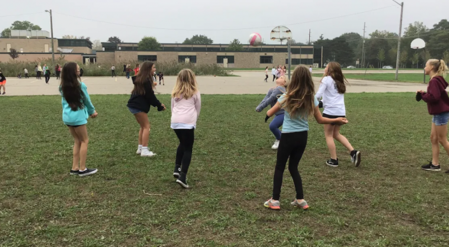 West 6th graders playing volleyball at recess.